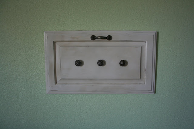 Repurposed cabinet door hooks