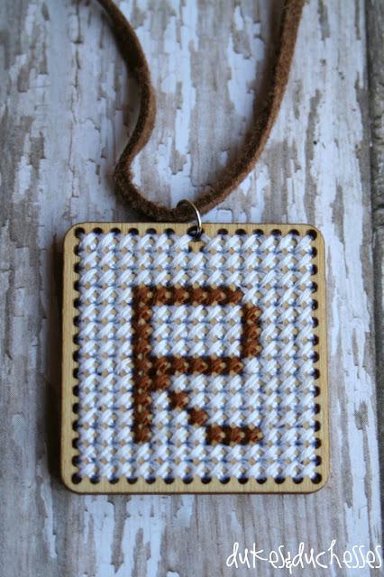 cross-stitched monogrammed pendant