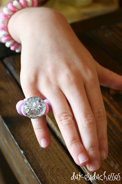 DIY glitter rings made with pipecleaner and button