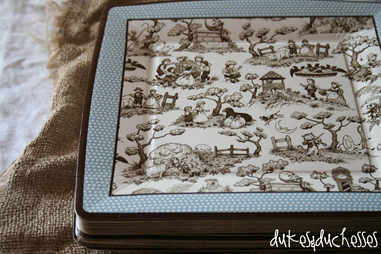 a simple baby shower: toile nursery rhyme plates