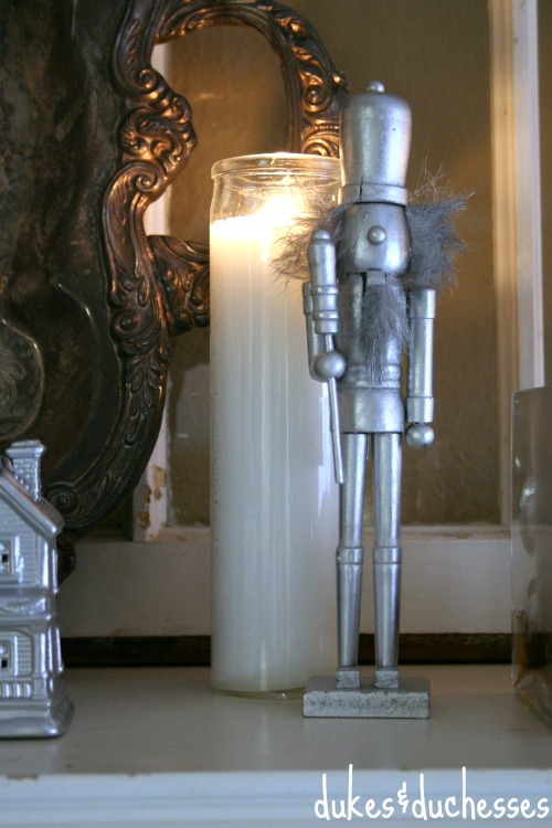 Spray Painted Silver Nutcracker on Mantel | #silverandgold #christmas #christmasdecor