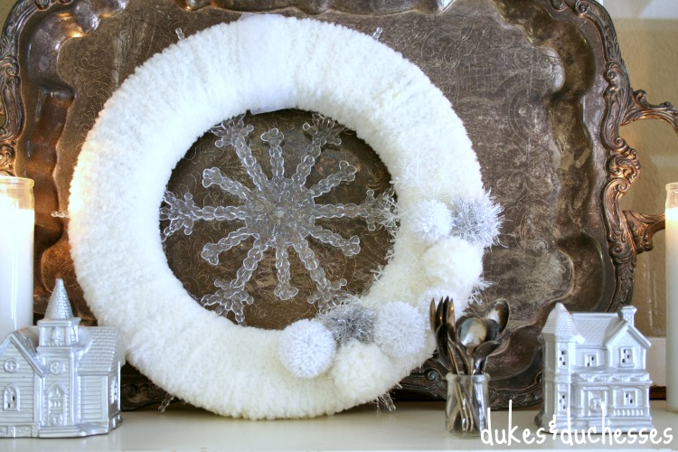 White Wreath on Mantel | #silverandgold #christmas #christmasdecor