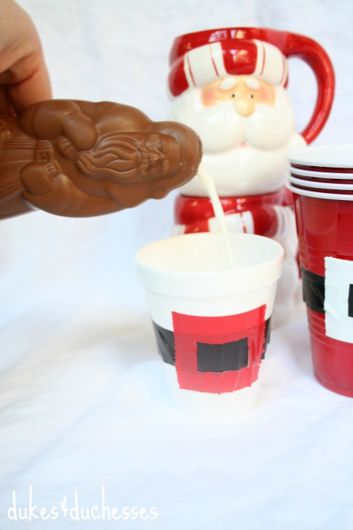pouring milk from chocolate santa