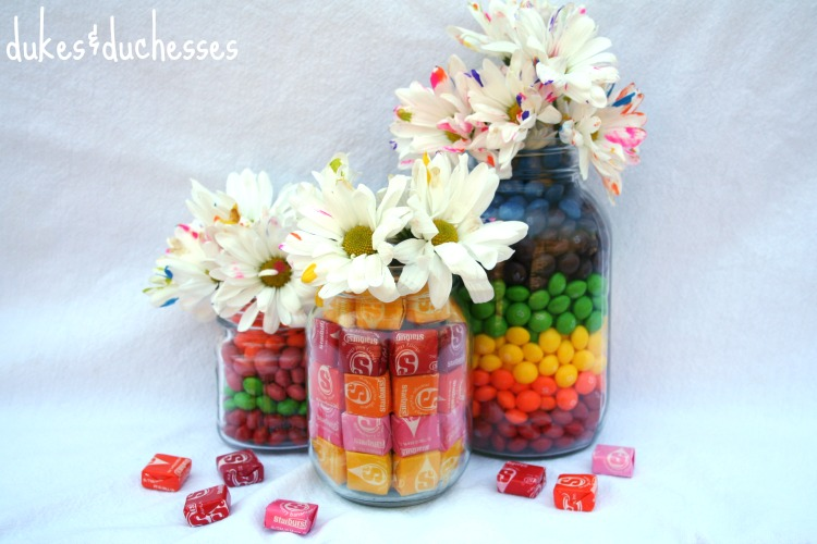 candy filled jars with flowers