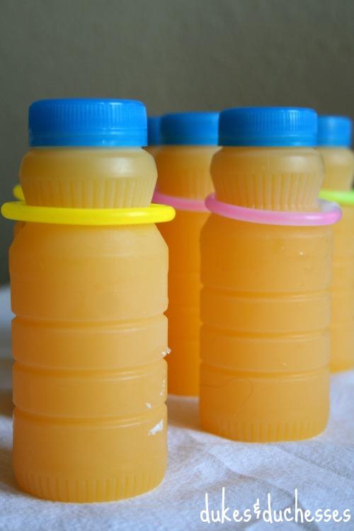 orange juice with glow stick wraps