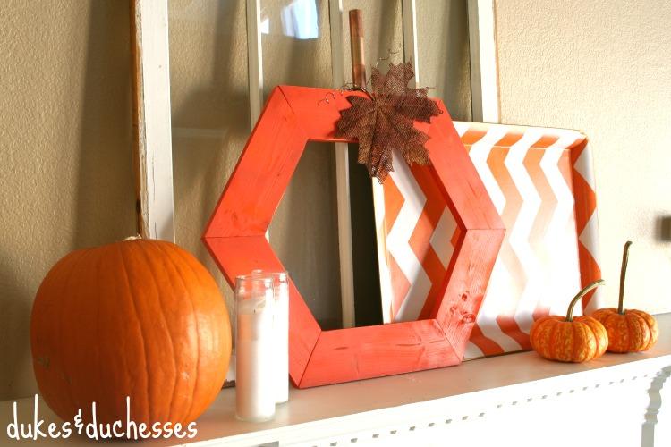 a fall mantel with a hexagon pumpkin