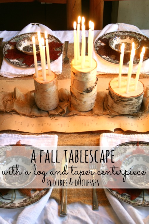 fall tablescape with a log and taper centerpiece