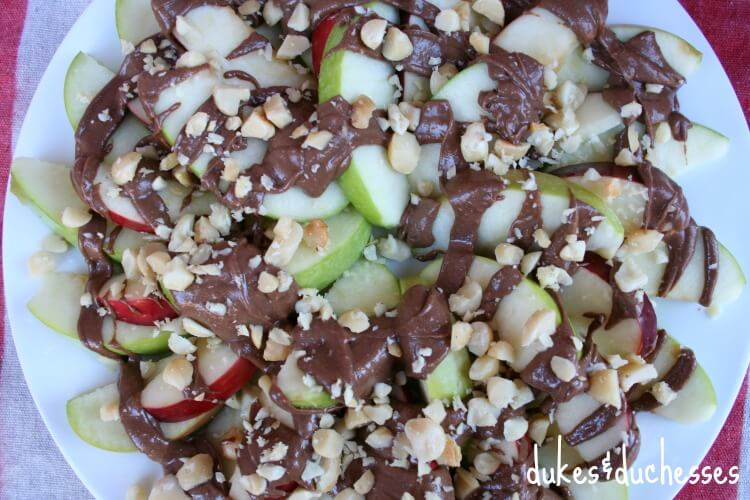 apple nachos topped with macadamia nuts