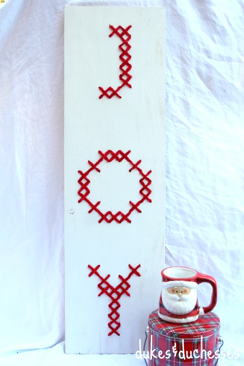 cross stitched wood sign