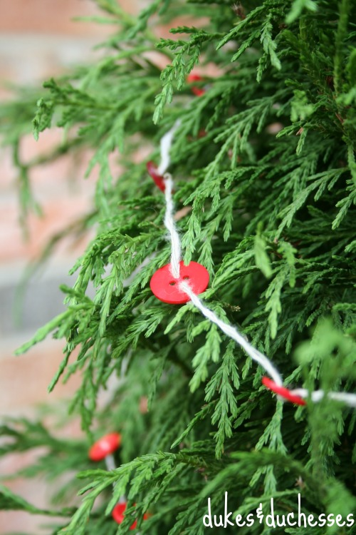 button garland on tree