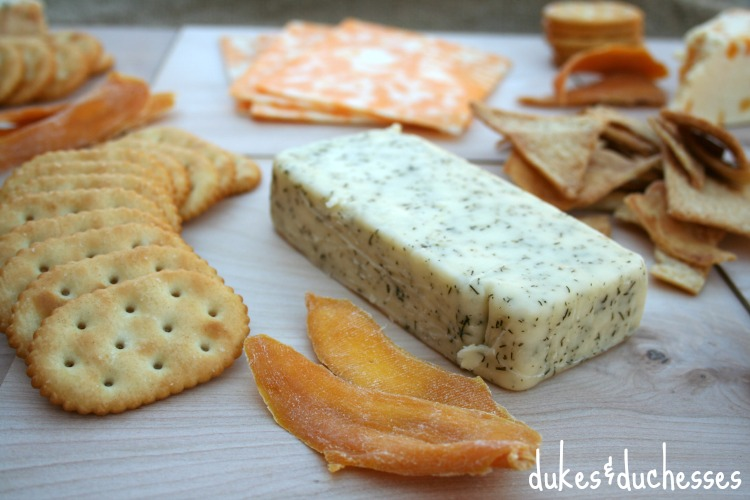 dried fruit on rustic cheese platter