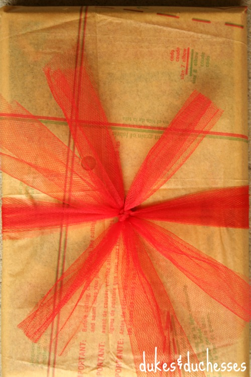 tulle bow on vintage pattern gift wrap
