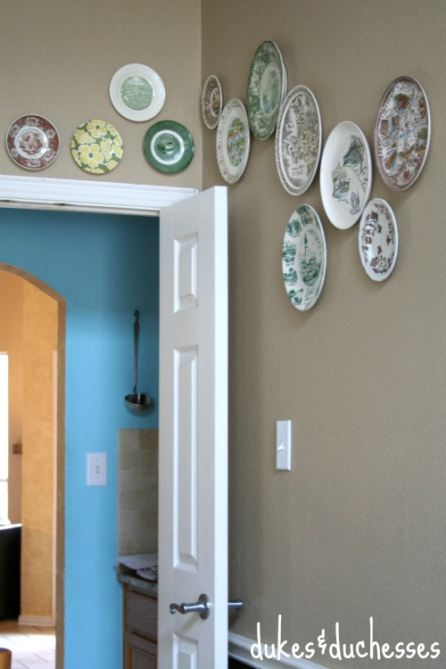 eclectic plate wall with vintage plates