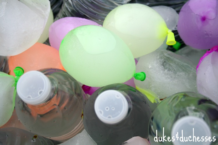 frozen water balloons in drink bucket at color fight party