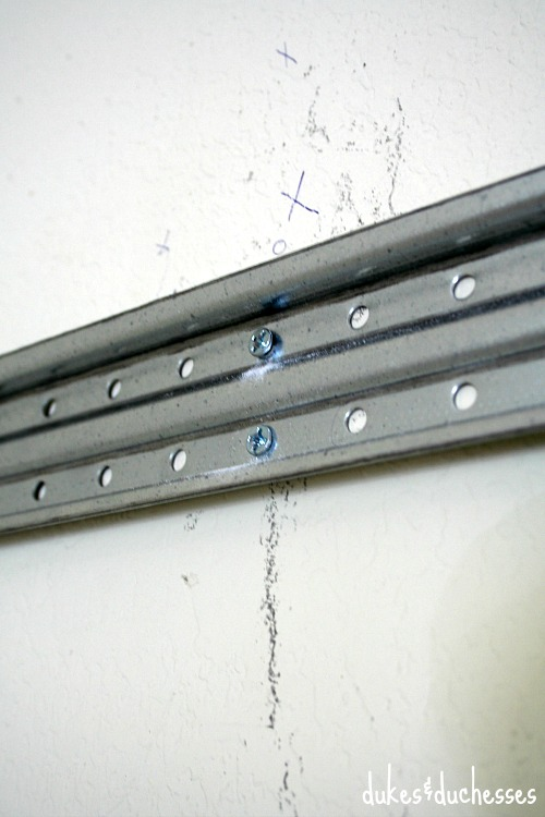 hanging fasttrack on wall