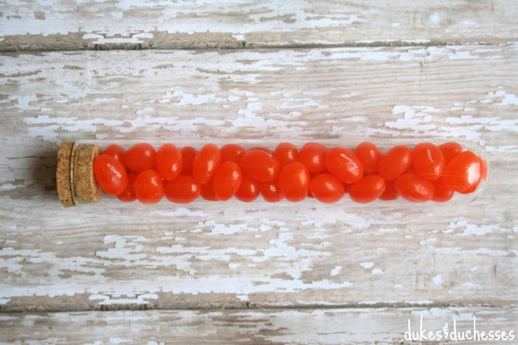 orange jellybeans in test tube