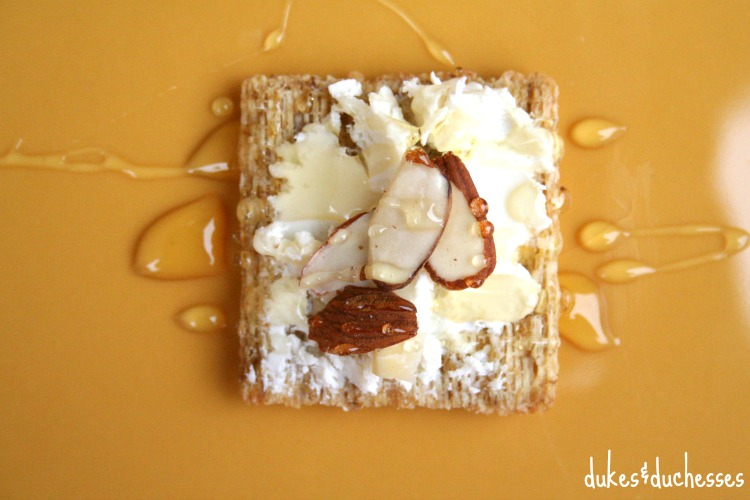 honey goat cheese almond on triscuit