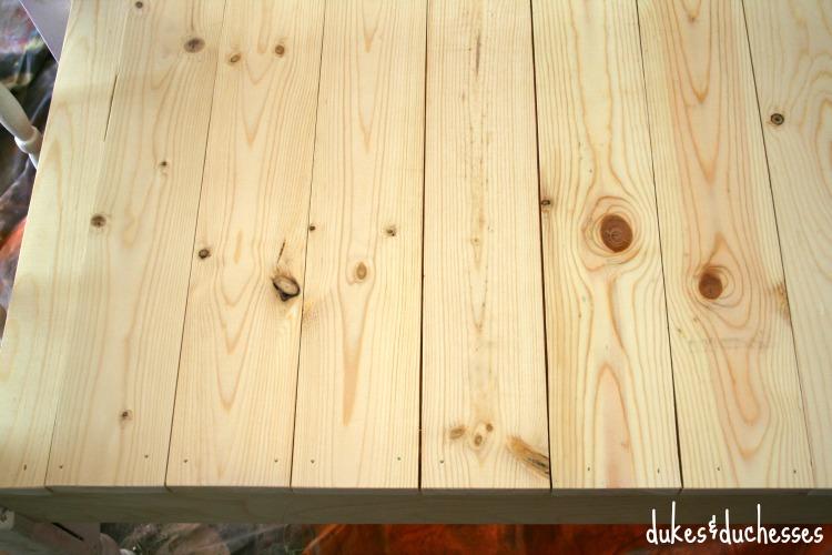 plank seating on headboard bench