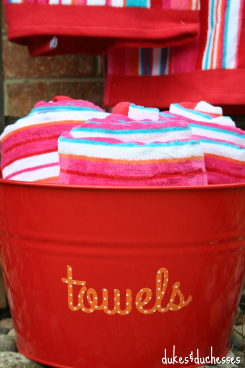 towel bucket by pool for outdoor entertaining