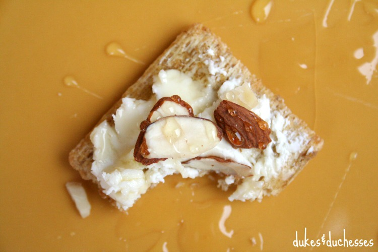 triscuit snack with goat cheese and honey