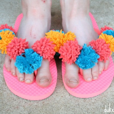 colorful pom pom flip flops