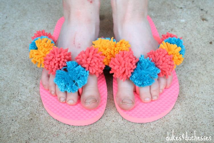 colorful pom pom flip flops