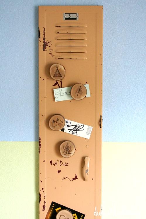 locker door with rustic wood slice magnets