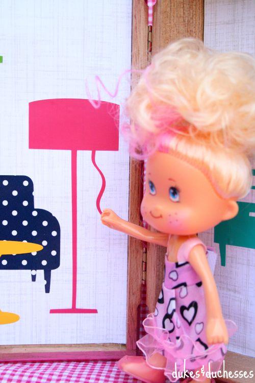 doll in cigar box doll house