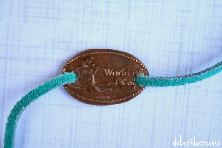 drilled coin with leather cord