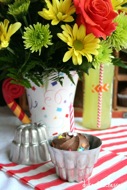 a birthday cupcake and flowers