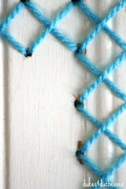 yarn cross stitch on wood