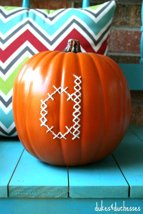 cross stitched monogram on a pumpkin