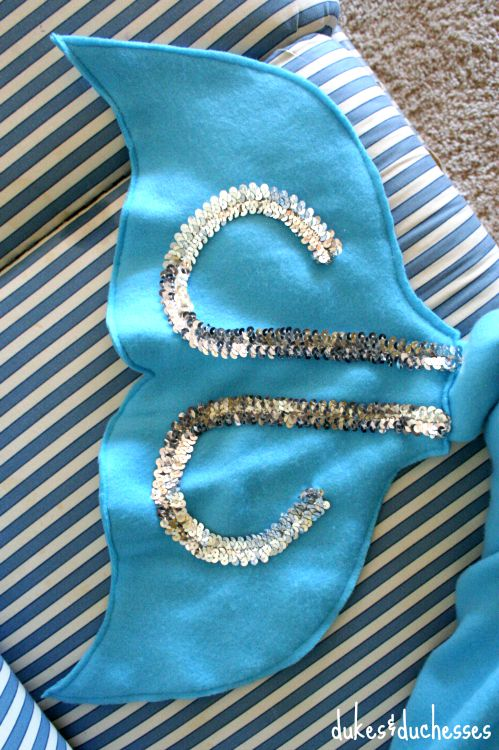 embellished mermaid tail on blanket