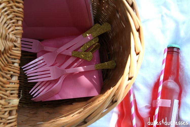 glittered utensils in picnic basket