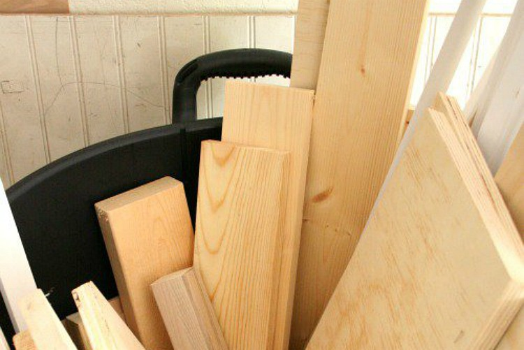 altered-trash-can-with-built-in-shelf-for-lumber-visual