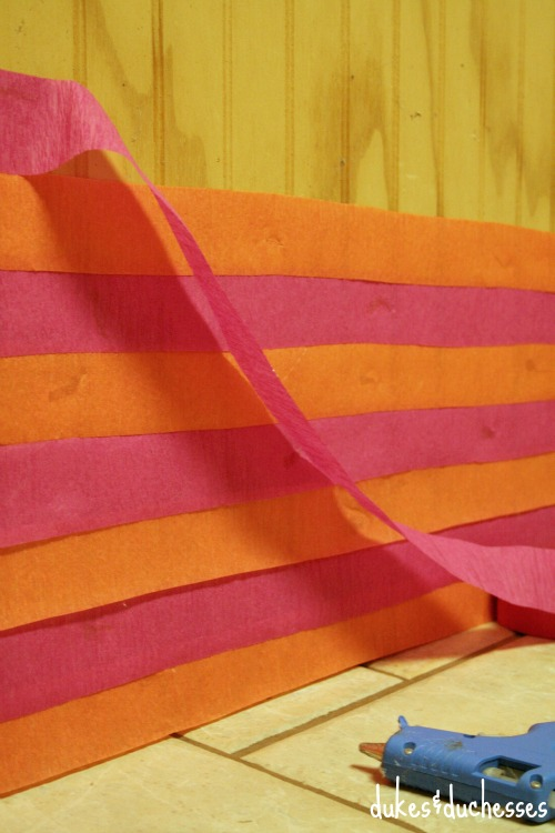 crepe paper streamers on photo booth backdrop