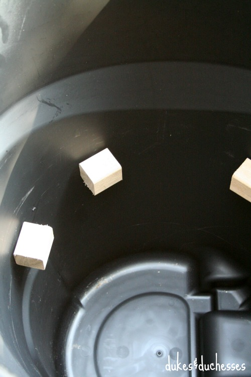 mounted wood blocks in roughneck trash can