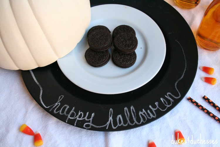 pumpkin cloche on chalkboard charger