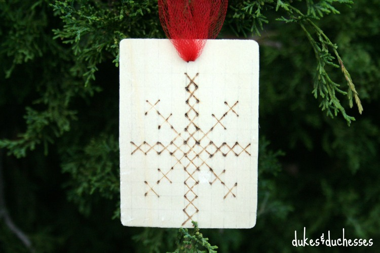 wooden cross stitch style ornament