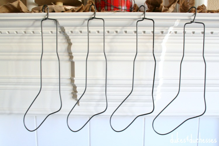 vintage stocking stretchers on christmas mantel
