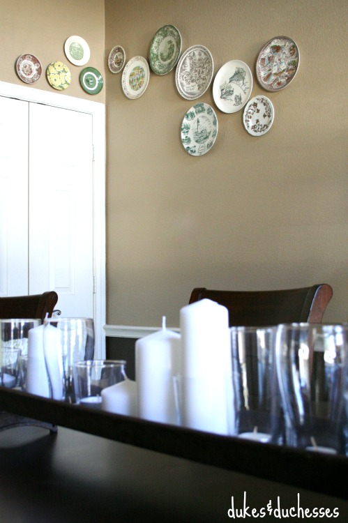 eclectic plate wall in dining room