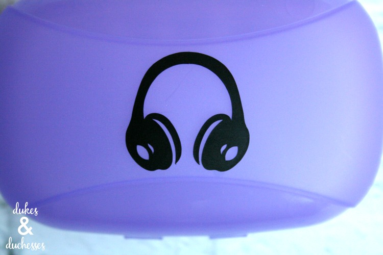 vinyl on upcycled earbud container