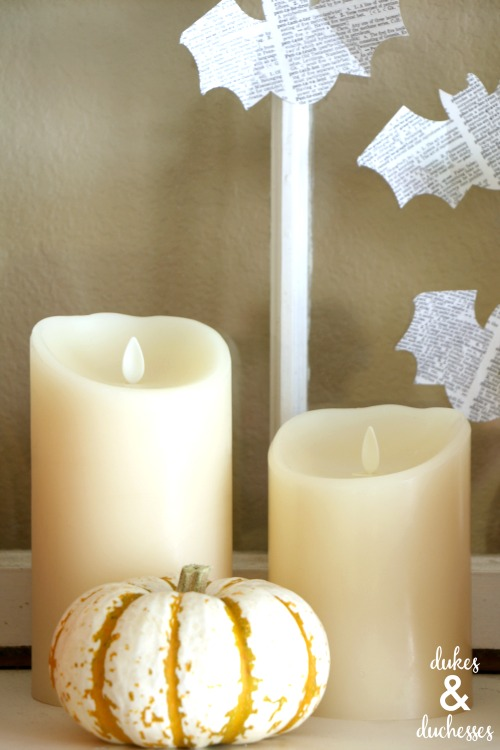 flameless candles on halloween mantel