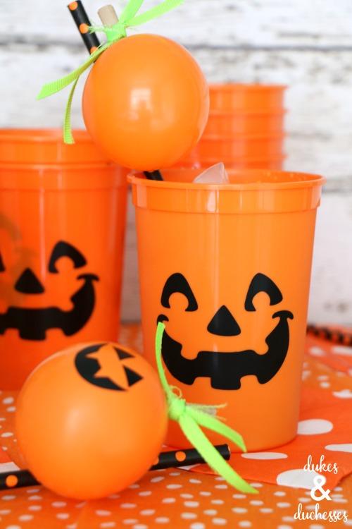 pumpkin balloons on straw