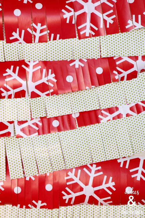 photo booth backdrop made with a wrapping paper garland