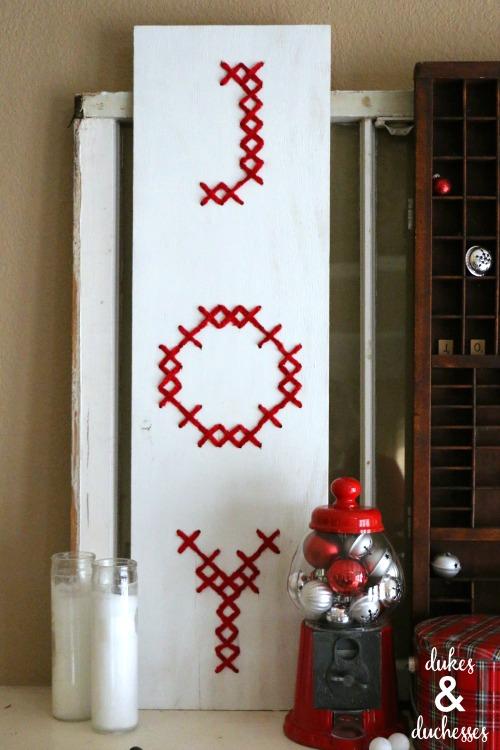 cross stitched wood joy sign