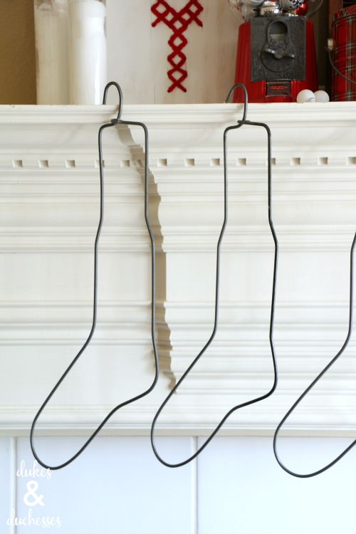 vintage sock stretchers hanging on mantel