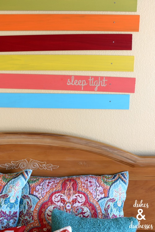 wood plank wall art over bed