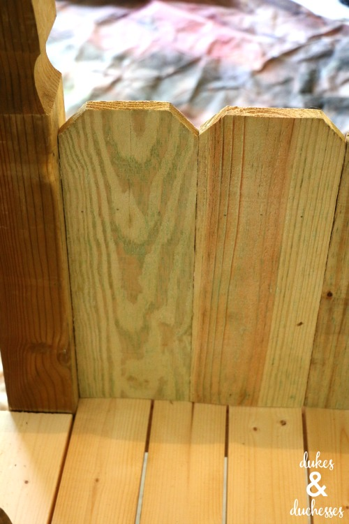 back of picket fence garden bench