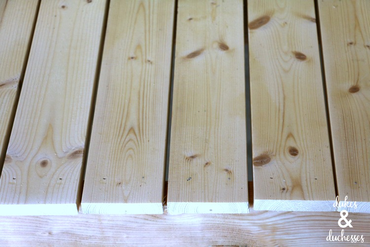 plank seating on picket fence bench